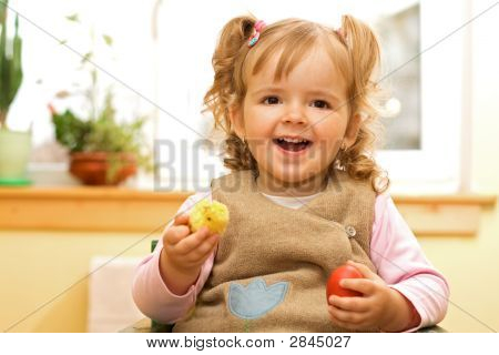 Happy Girl With Easter Egg And Decoration In Hands
