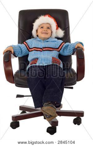 Happy Boy Waiting Santa In A Revolving Armchair - Studio Shot