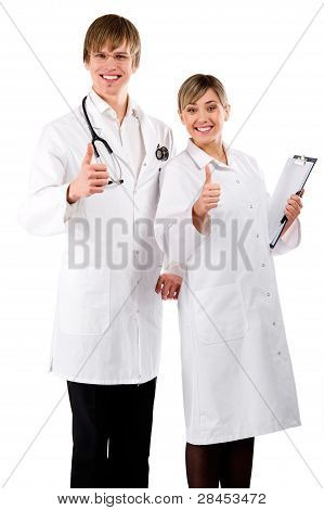 Happy Male And Female Doctors With Thumbs Up Isolated On White Background