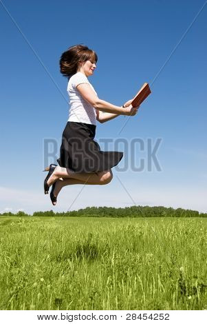 Flying girl reads a book