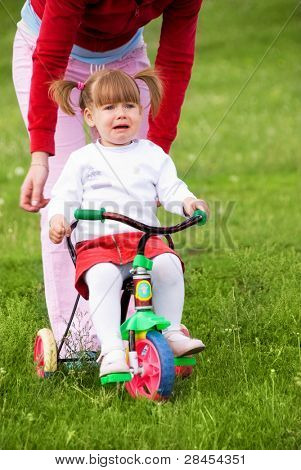 Little girl scared of riding a bicycle