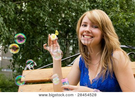 pretty girl with soap bubbles in the park