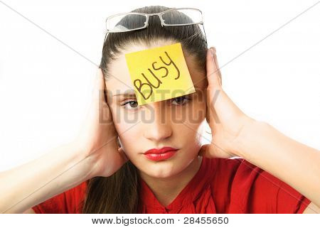 "portrait of a tired unhappy businesswoman with a note ""busy"" on her forehead"