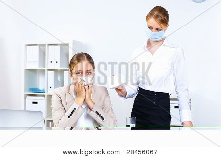 People with cold and flu  at work place