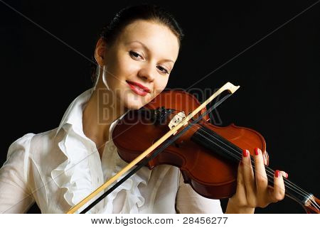 portrait of a pretty young woman playing the violin