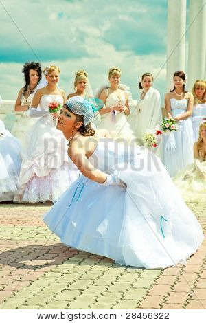 KRASNOYARSK, RUSSIA - JUNE 21: young bride posing for photographers at Parade of Brides June 21, 2009 in Krasnoyarsk. The annual summer event takes place in many Russian cities.