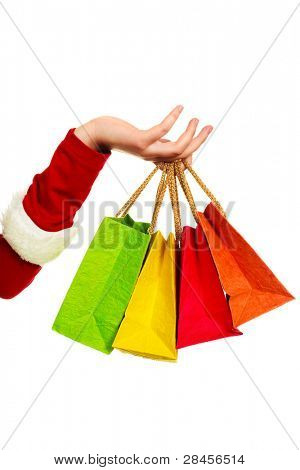 close up of the hand of a woman dressed as Santa holding four shopping bags