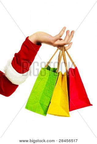 close up of the hand of a woman dressed as Santa holding three shopping bags