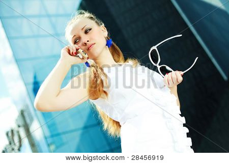 beautiful young woman talking on the cell-phone outdoor