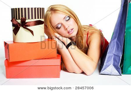 pretty young woman tired of shopping with a lot of shopping bags