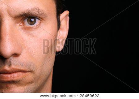 young man over black background (half portrait)