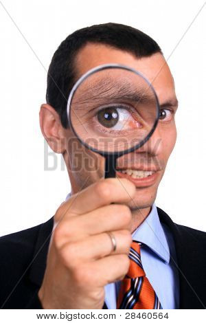 business man with a loupe over white background