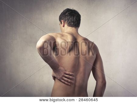 Rear view of a young man suffering from backache