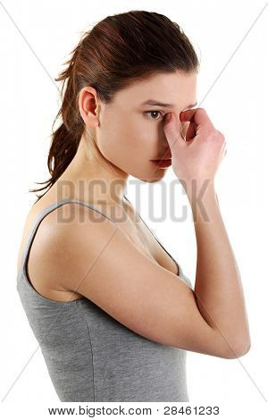Young teen woman with sinus pressure pain, isolated on white
