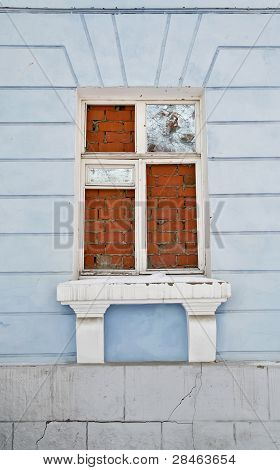 Broken Window Clamped Bricks, Against Walls Painted In Blue