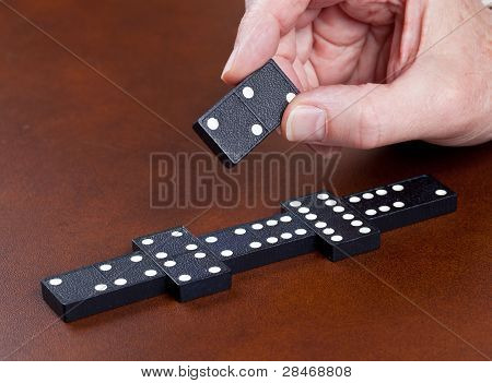 Game Of Dominoes On Leather Table