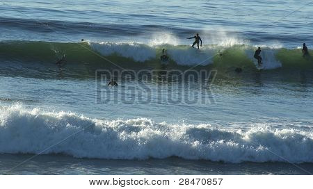 Huge Waves Attract Local Surfers