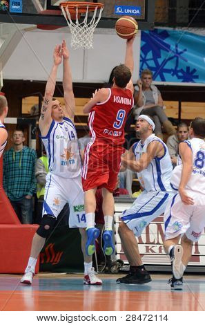 KAPOSVAR, HUNGARY - NOVEMBER 19: Jozsef Lekli (white 14) in action at a Hugarian National Championship  basketball game Kaposvar (white) vs. Paks (red) November 19, 2011 in Kaposvar, Hungary.