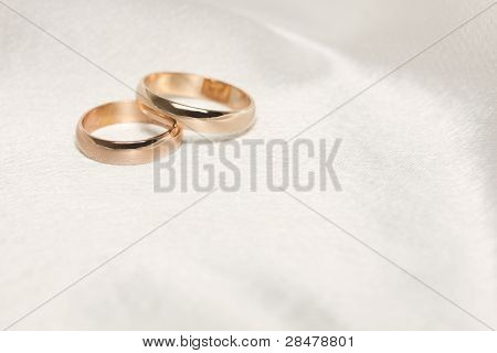 Two  Weddings Rings On White  Fabric