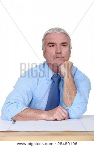 Businessman lost in thought