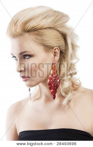Red Earring On Cute Blond Girl, She Is Turned Of Three Quarters