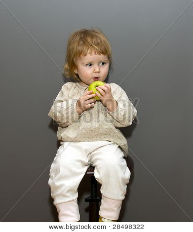 Cute Little Baby With Green Apple On Grey Background