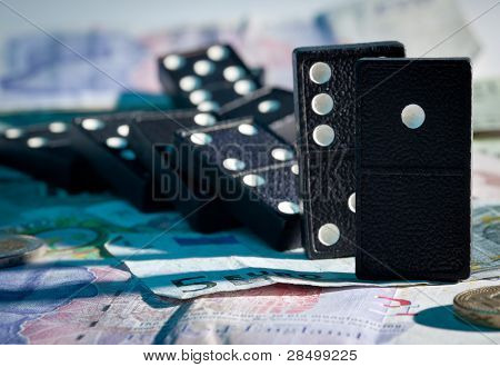 Fallen Dominoes On Bank Notes