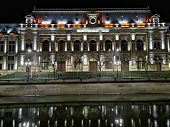 Palace Of Justice In Bucharest, At Night . It Was Designed By The Architects Albert Ballu And Ion Mi poster