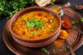 Indian Dal. Traditional Indian Soup Lentils.  Indian Dhal Spicy Curry In Bowl, Spices, Herbs, Rustic poster