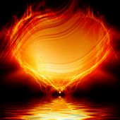 stock photo of soulmate  - Heart on fire on a dark black background - JPG