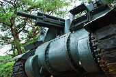stock photo of panzer  - Old Green Heavy War Tank Photographed on a Low Angle - JPG