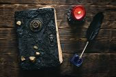 Ancient Magic Book, Ink Well And A Quill Pen On A Wooden Table Background. Spell Book. Flat Lay. poster