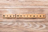 Stay Motivated Word Written On Wood Block. Stay Motivated Text On Wooden Table For Your Desing, Conc poster