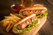 Photo Of Barbecue Grilled Hot Dog With Yellow Mustard And Ketchup On Wooden Background. Hot Dog Sand poster