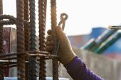 Using Steel Wire For Securing Steel Bars With Wire Rod For Reinforcement Of Concrete Or Cement. Focu poster