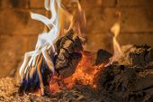 Home Fireplace With Beautiful Orange Fire And Wood Fire Close. Burning Fire In The Fireplace. Logs O poster