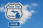 Michigan Road Trip Highway Sign, Michigan Map And Text Road Trip On A Highway Sign With Sky Backgrou poster