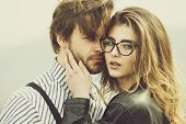 Couple In Love. Girl Or Woman In Stylish Glasses With Fashion Makeup And Long Hair Touching Face Of  poster