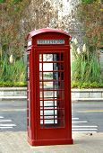 pic of dial pad  - Vintage telephone booth sits on city square - JPG