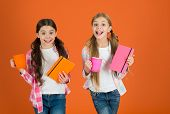 Girls Kids With Books And Tea Mugs Orange Background. Friends Spend Leisure Reading Books. Having Br poster