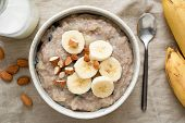 Oatmeal Porridge With Banana And Nuts, Top View. Vegan, Vegetarian Breakfast Meal, Healthy Eating Co poster