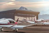 Private Propeller Planes Parked At The Airport. Private Airplanes At Sunset. poster