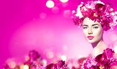 Beauty Spring Model Girl with peony flowers on her head on beautiful pink blurred background. Peony  poster