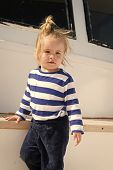 Kids Fashion On Vacation. Boy Adorable Sailor Striped Shirt Yacht Travel Around World. Baby Boy Enjo poster
