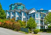 Modern Apartment Building On Sunny Day. Residential Apartment Building In Vancouver, British Columbi poster