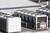 stock photo of air compressor  - view on the roof of a building of a large air conditioning equipment - JPG