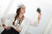 Portrait Of Beautiful Hippie Girl Making A Selfie With An  Antique Camera poster