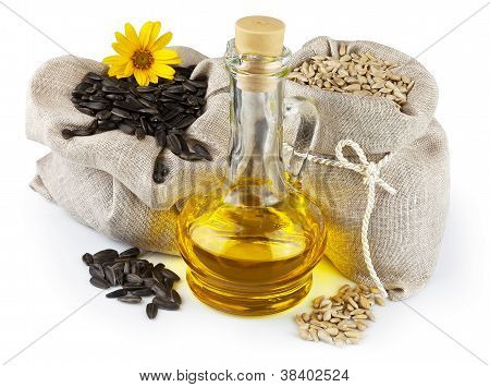 Sacks Of Sunflower Seeds And Glass Bottle Of Oil
