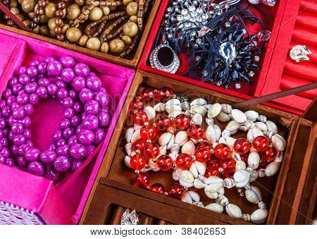 Boxes Of Different Colors With Jewelry