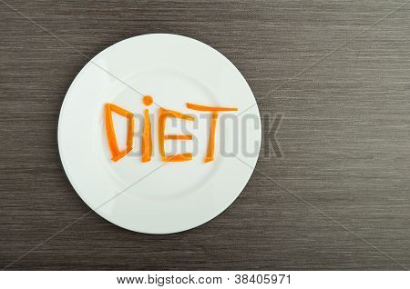 Diet Concept. Design Food. Word  Diet Carrots On  Plate